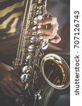 the hands of a teen musician... | Shutterstock . vector #707126743