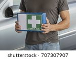 man holding first aid kit for... | Shutterstock . vector #707307907
