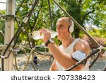 photo of a young man drinking... | Shutterstock . vector #707338423