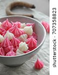 Small photo of Aalaw or Alua, Thai traditional candy sweet dessert, food background, pattern and texture of sweet in pastel color,White, pink
