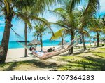 Small photo of The An Bang beach with sunbathing girl in Hoi An town. Quang Nam Province, Vietnam