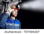 young miner man underground in... | Shutterstock . vector #707404207
