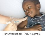 happy african child gets a... | Shutterstock . vector #707462953
