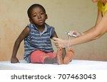 sad african boy ready to get an ... | Shutterstock . vector #707463043