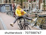 Young Woman In Yellow Raincoat...