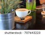 empty cup of coffee on wooden... | Shutterstock . vector #707643223