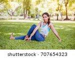 asian woman practicing yoga in... | Shutterstock . vector #707654323