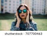 girl in sun glasses | Shutterstock . vector #707700463