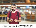 handsome man holding his... | Shutterstock . vector #707733193