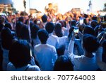 cheering crowd in front of... | Shutterstock . vector #707764003