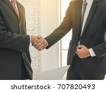 two businessman shake hand for... | Shutterstock . vector #707820493