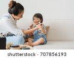 cute little girl and her... | Shutterstock . vector #707856193