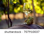 a glass of white wine with... | Shutterstock . vector #707910037
