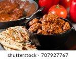 chicken tikka masala served... | Shutterstock . vector #707927767