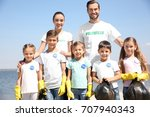 young volunteers and children... | Shutterstock . vector #707940343