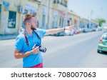 young tourist in corfu town ... | Shutterstock . vector #708007063