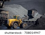 Bulldozer Moving Coal