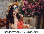 pretty brunette outdoors | Shutterstock . vector #708060043