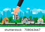 hand picks a house. suburban... | Shutterstock .eps vector #708063667
