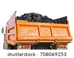 Small photo of Coal in the back of the orange truck isolated on white background. ?oal mining. Coal delivery