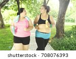 two overweight happy women... | Shutterstock . vector #708076393