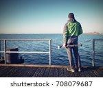 travel photographer on pier.... | Shutterstock . vector #708079687