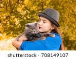 beautiful girl with fluffy pet... | Shutterstock . vector #708149107