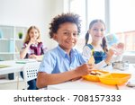cute youngsters with cracker... | Shutterstock . vector #708157333
