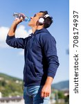 young man drinking water after... | Shutterstock . vector #708174937