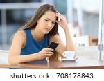 single worried woman watching a ... | Shutterstock . vector #708178843