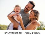 parents having fun with their... | Shutterstock . vector #708214003
