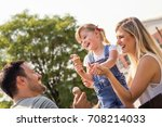 happy young family eating ice... | Shutterstock . vector #708214033