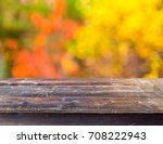 empty wooden table with autumn... | Shutterstock . vector #708222943