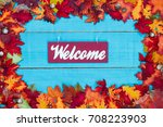 Welcome Sign With Colorful Fal...