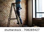 handyman working renovating... | Shutterstock . vector #708285427