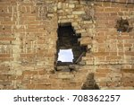 Old Brick Wall With A Hole In...