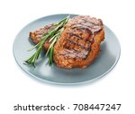 plate with tasty steaks on... | Shutterstock . vector #708447247