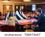 cute lady casino dealer at... | Shutterstock . vector #708473047