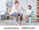 young boy and counselor having... | Shutterstock . vector #708493183