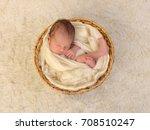 wrapped newborn baby sleeping... | Shutterstock . vector #708510247