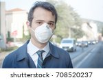 man wearing mask against smog... | Shutterstock . vector #708520237
