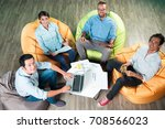 happy people sitting on beanbag ... | Shutterstock . vector #708566023