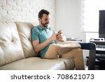 attractive latin man relaxing... | Shutterstock . vector #708621073