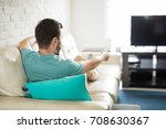 man relaxing at home sitting in ... | Shutterstock . vector #708630367
