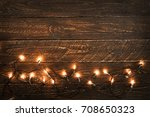 christmas lights bulb on wood... | Shutterstock . vector #708650323