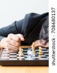 Small photo of Business woman face down on the table losing game over with chess board for business challenge metaphor and lose compitition concept on the white background