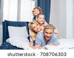 happy young family with two... | Shutterstock . vector #708706303