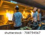 chef in restaurant kitchen at... | Shutterstock . vector #708754567
