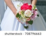 beautiful bride is holding a... | Shutterstock . vector #708796663