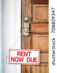 Small photo of Rent Now Due Sign